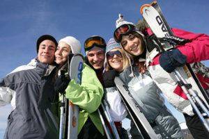 A group of 5 young skiiers